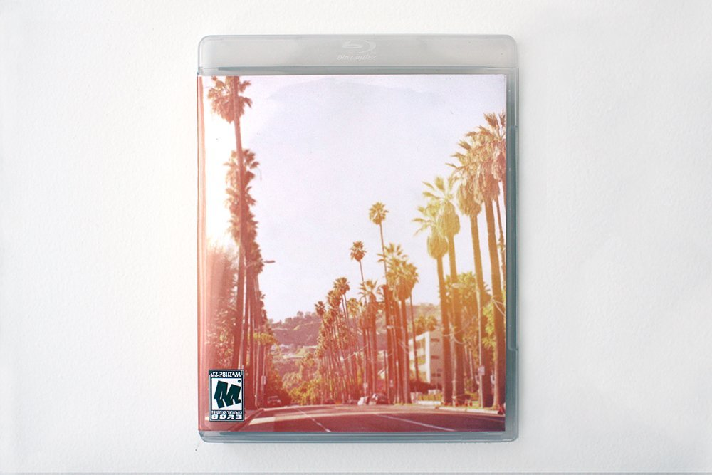 Andrea Crespo, ΑΩ, 2014, Playstation 3 game disc case, images, lottery ticket, quote by Elliot Rodger(UC Santa Barbara) (Front)